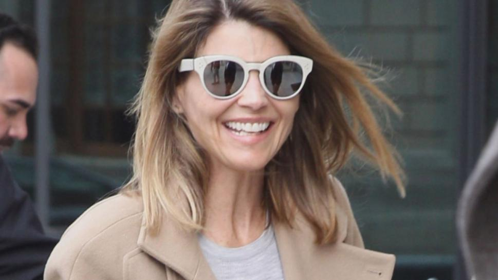 Lori Loughlin flew into Boston on a private jet and took the time to sign autographs at the airport, all the while smiling and chatting, putting on a brave face.