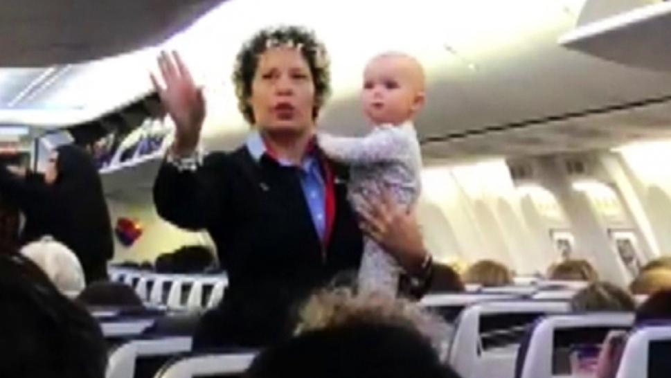 Southwest Flight Attendant Calms Fussy Baby