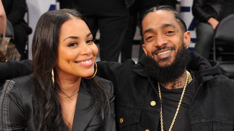 Lauren London and Nipsey Hussle enjoy a basketball game at LA's Staples Center in 2018.