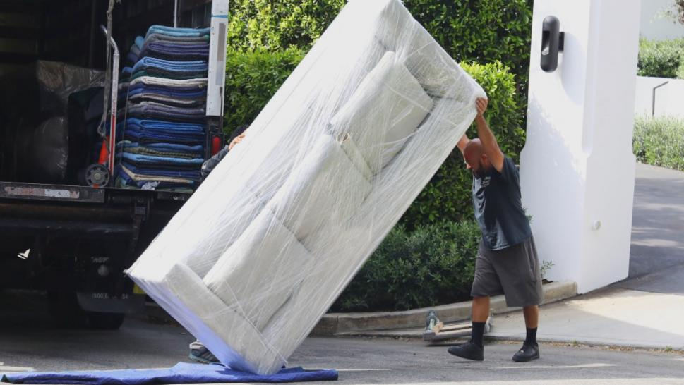 Movers moving furniture from Lori Loughlin's house