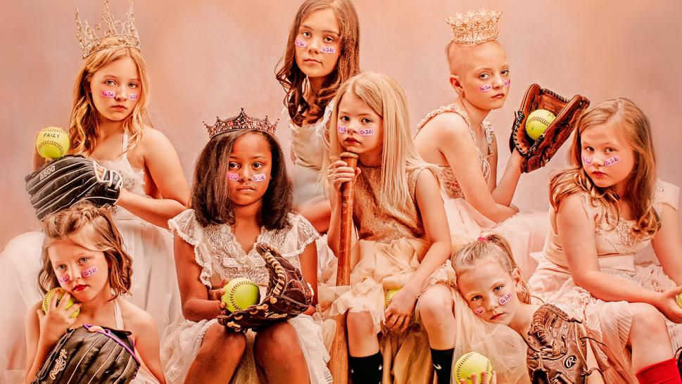 Young girls pose among sporting equipment to challenge gender stereotypes.