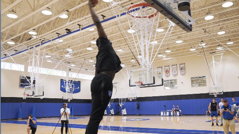 Zion Williamson dunked the ball for the reveal.