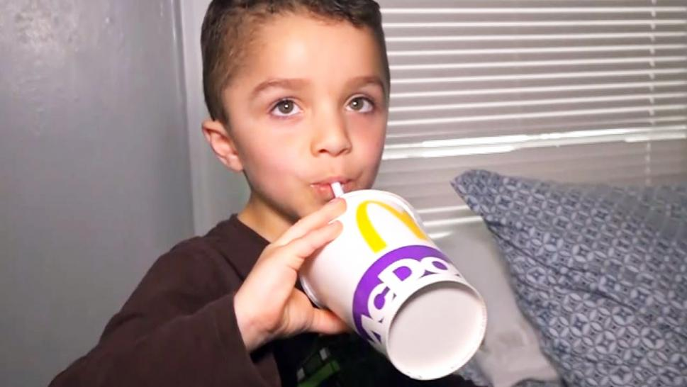 Iziah Hall, 5, sips his McDonald's Drink.