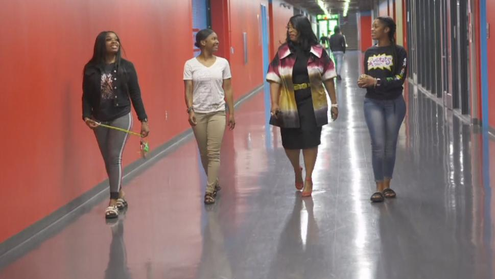 Carlotta Outley Brown, principal of James Madison High School, walks the halls of the school.