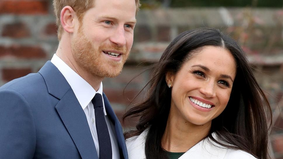 Prince Harry and Meghan Markle pose together.