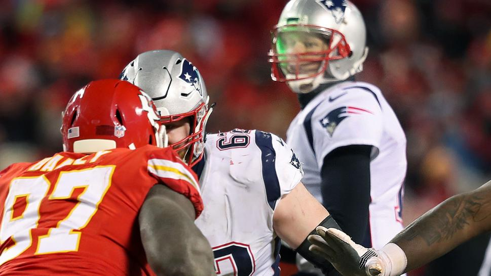 What appears to be a green laser can be seen reflecting off the helmet of Tom Brady.