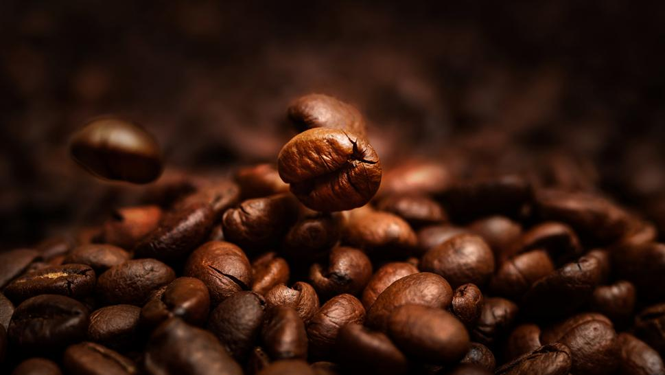 A stock image of coffee beans is seen here.