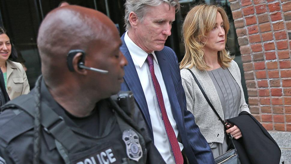 Felicity Huffman walks hand in hand with her brother, Moore.
