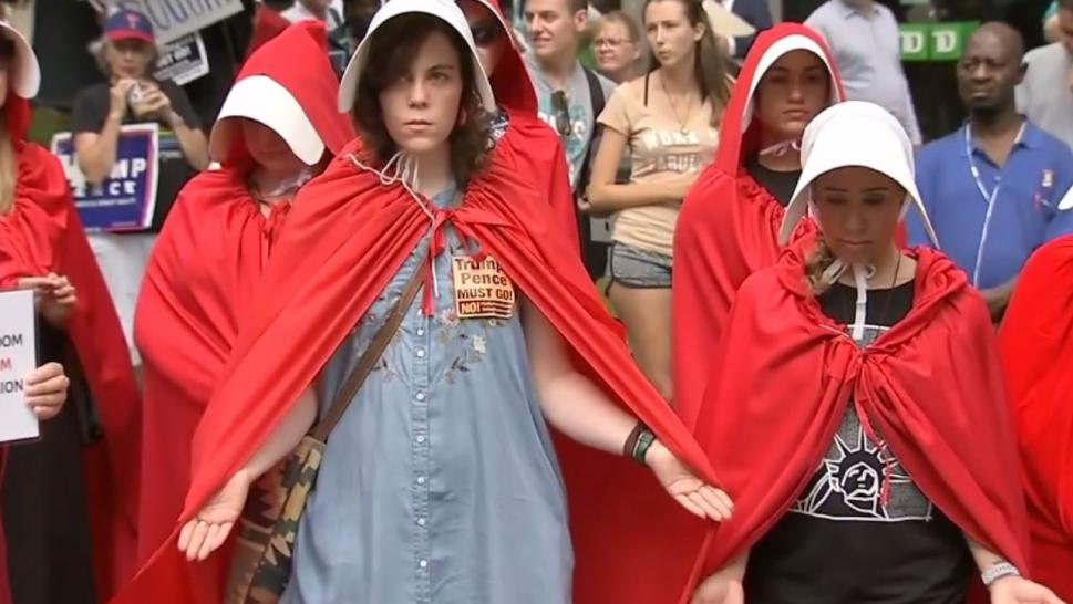"""The Handmaid's Tale"" costume is turning into the new go-to protest attire for women."
