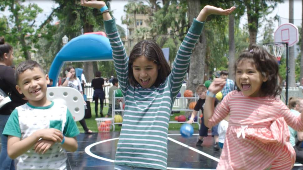 Kids play at the World's Biggest Playdate hosted by Little Tikes in Pasadena, California