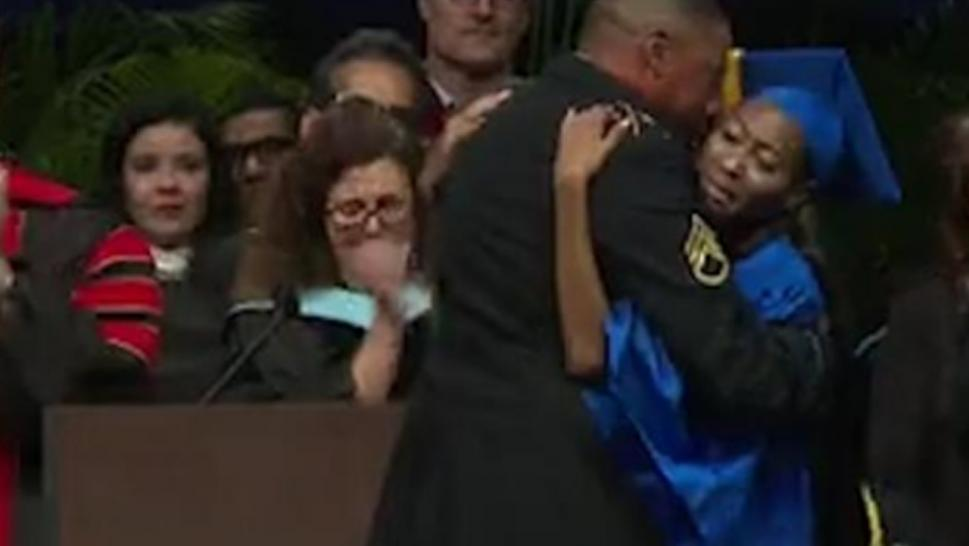 Kayla Tillman's father surprised her at her high school graduation.