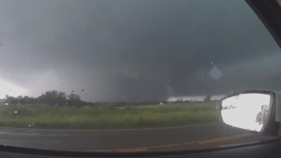 KCTV's Emily Rittman was reporting live on air when her anchor warned her to run from an approaching tornado.