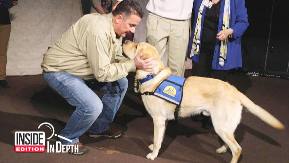 9/11 firefighter Paul Monfre received service dog Valor from Canine Companions for Independence in New York.