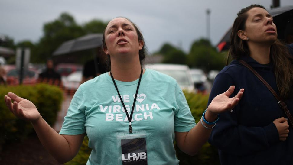 A woman mourns after a gunmen killed 12 people in Virginia Beach.