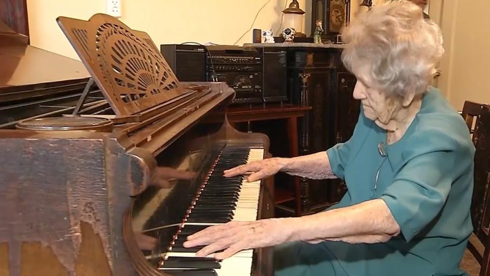 This elderly woman isn't let age stop her from her love of instruments.