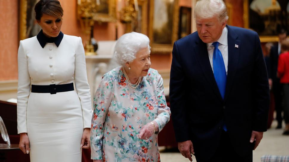 The Trumps and Queen Elizabeth II examine the Royal collection at Buckingham Palace.