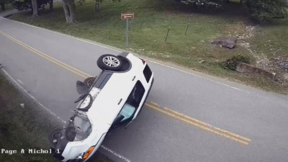 Dramatic footage shows a car flipping over after the driver sneezed.