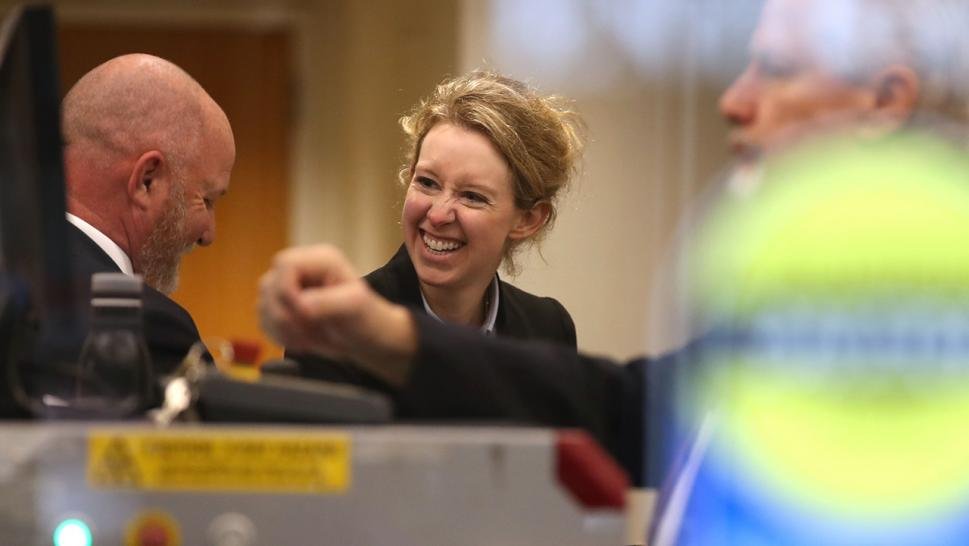 Elizabeth Holmes walks through security as she arrives at court in January 2019.