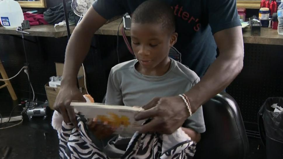 A barber is giving discounted haircuts to kids who read.