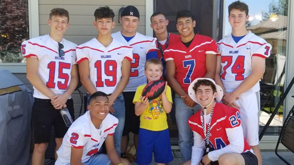 An entire football team came to birthday party for boy with autism.