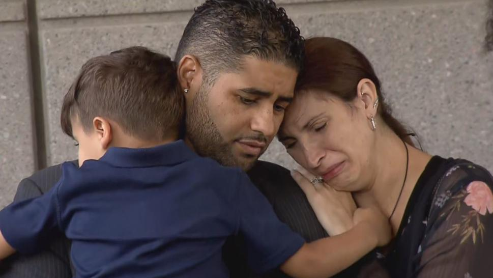 Bronx native Juan Rodriguez cradled his 4-year-old son as his wife, Marissa, wept on his shoulder Thursday morning outside court.