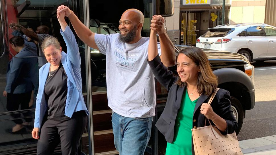 John Miller (center) celebrates his freedom with his legal team after spending 21 years in prison for a crime he did not commit.