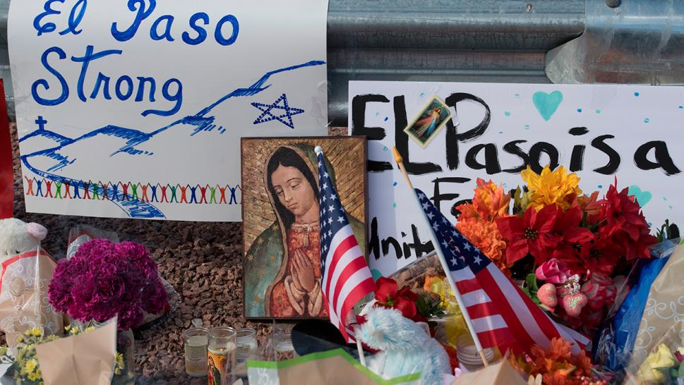 Two shootings in less than 24 hours have left 31 dead and America in mourning. Pictured, signs in El Paso, Texas.