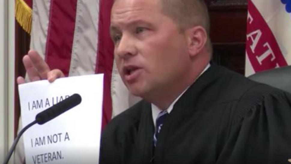 Montana judge orders two men who lied about military experience to wear signs.