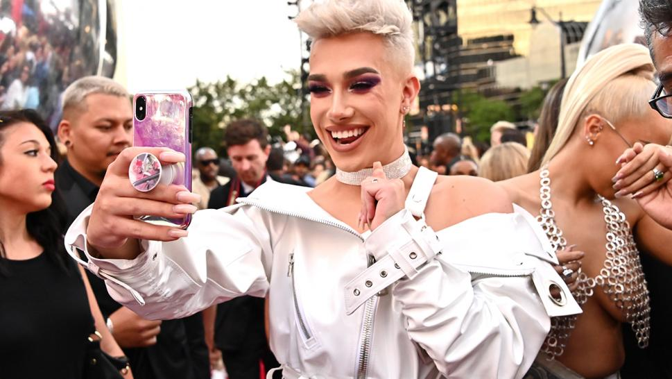 James Charles snaps a selfie on the red carpet of the MTV Video Music Awards.