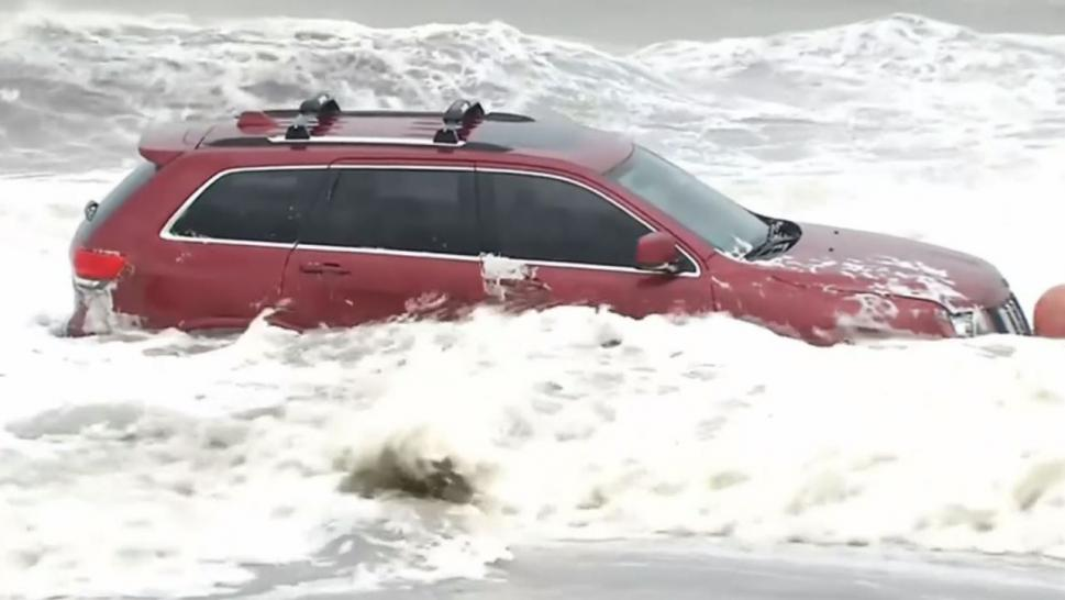 Inside Edition spoke to the SUV's owner, Brittany Feliciano, who says it wound up there after her husband loaned it to his cousin to take photos on the beach.