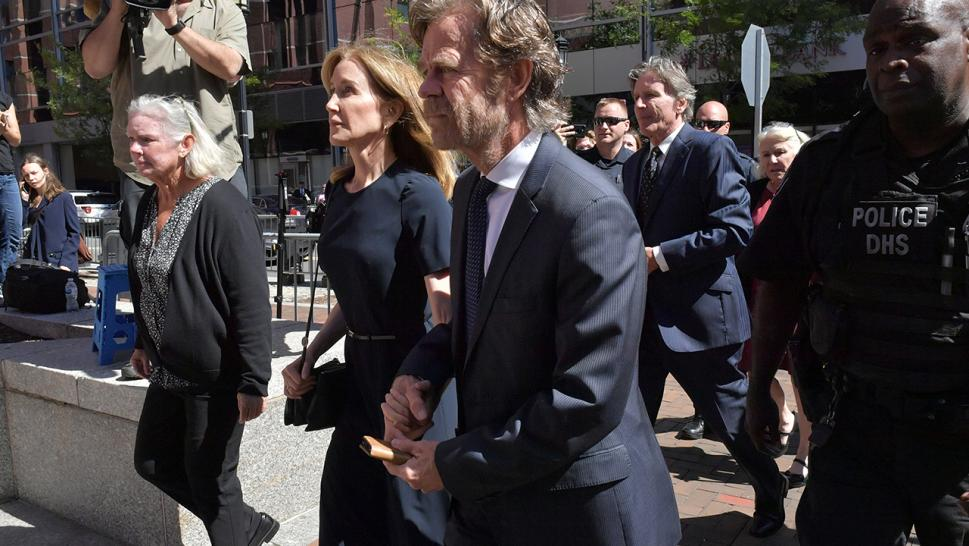 Felicity Huffman walks into court on Sept. 13 along with husband William H. Macy.