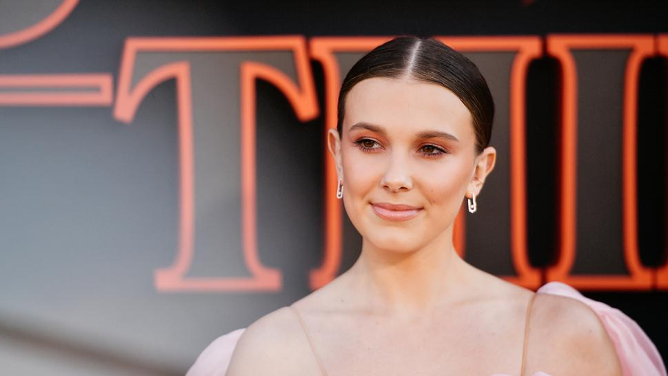 Fans are criticizing Millie Bobby Brown for seeming to fake a skincare tutorial on YouTube.