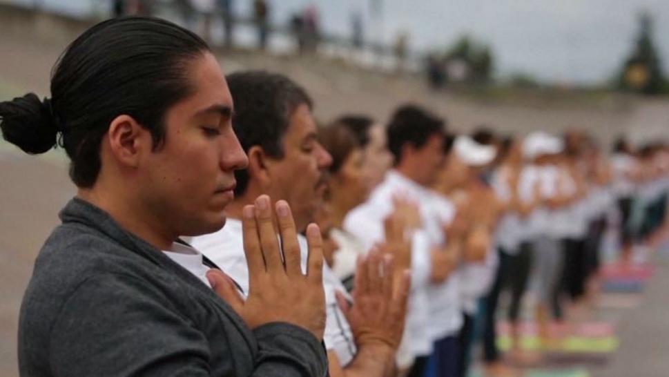Dozens practiced yoga at the U.S.-Mexico Border