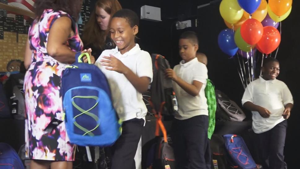 These school kids got quite the surprise when they were given new backpacks full of supplies.