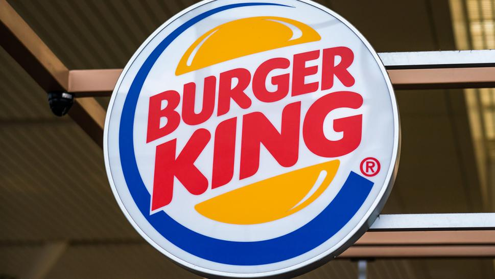 An Ohio woman says she caught a Burger King employee snapping a photo of her credit card at the drive-thru.