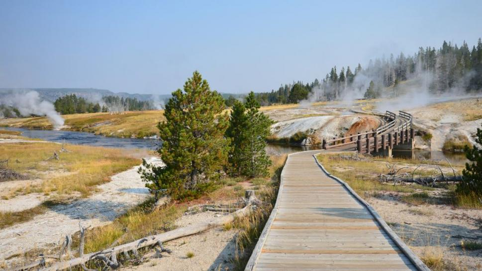 The man fell into a hot spring near Old Faithful, park rangers said.