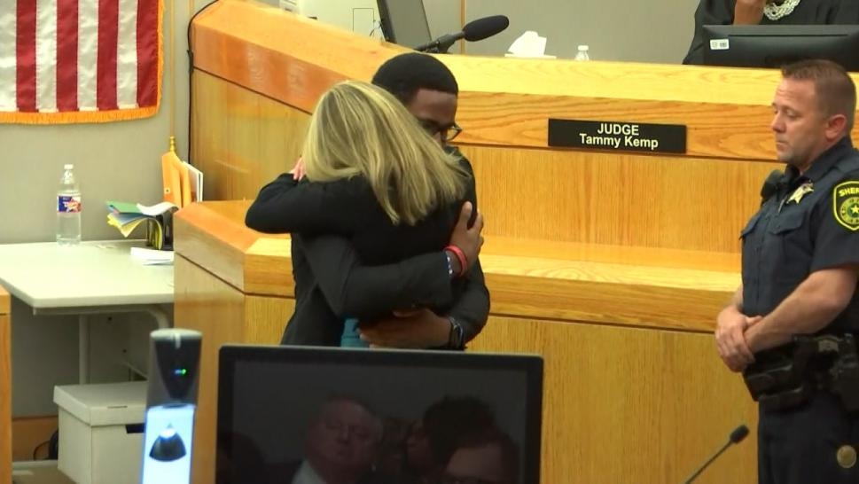 Botham Jean's Brother Hugs Amber Guyger in Court