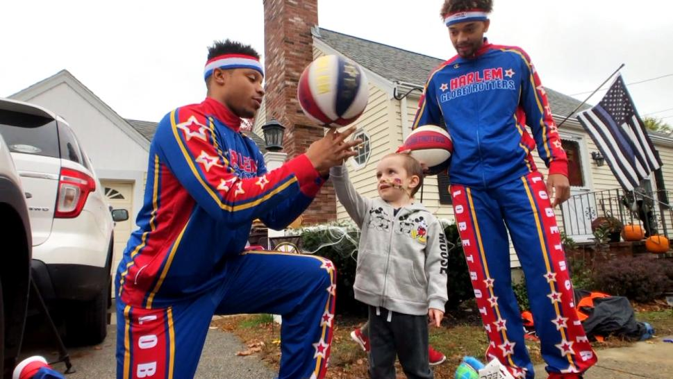 Quinn Waters, a toddler battling cancer, met the Harlem Globetrotters.