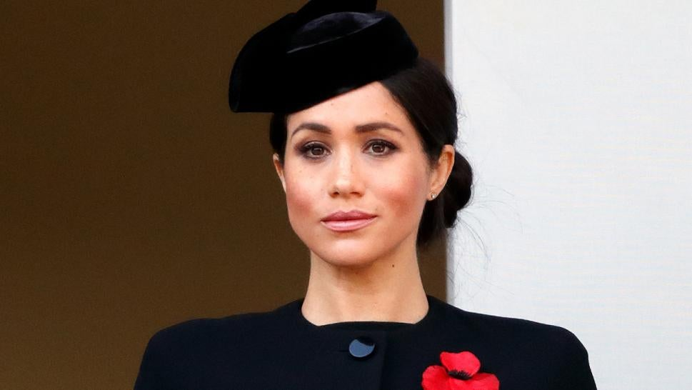 Meghan Markle stood on a separate balcony.