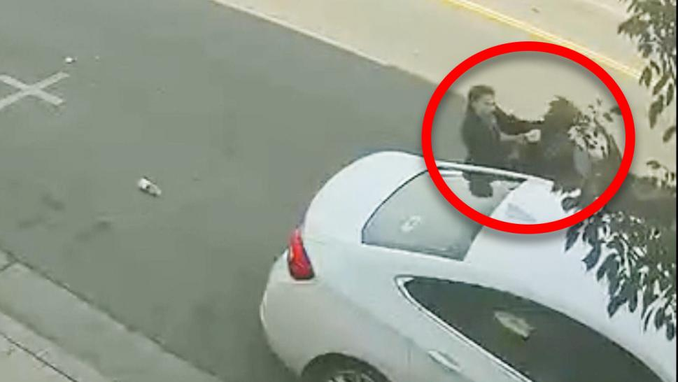 Woman kicked out of car