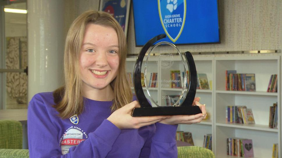 14-year-old Alaina Gassler holds up the prestigious award she won at the annual Broadcom MASTERS competition from the Society for Science & the Public
