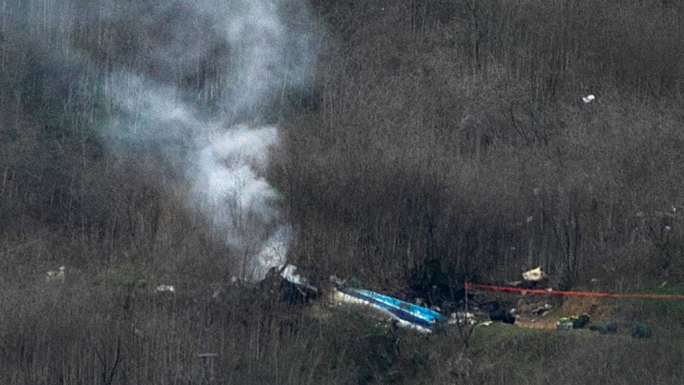 smoke rising off helicopter crash in hills
