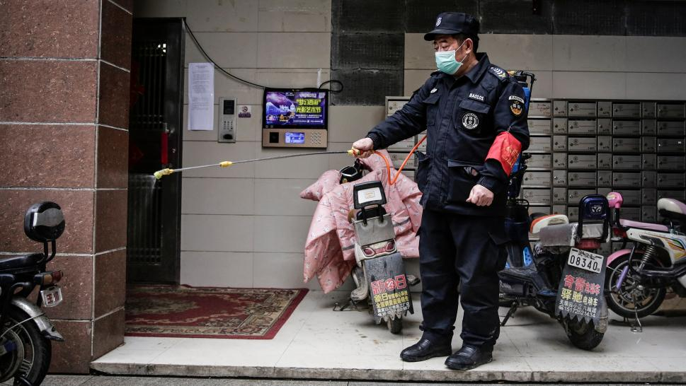 A worker sanitizes a building in Wuhan, China\, which is facing an outbreak of the coronavirus.
