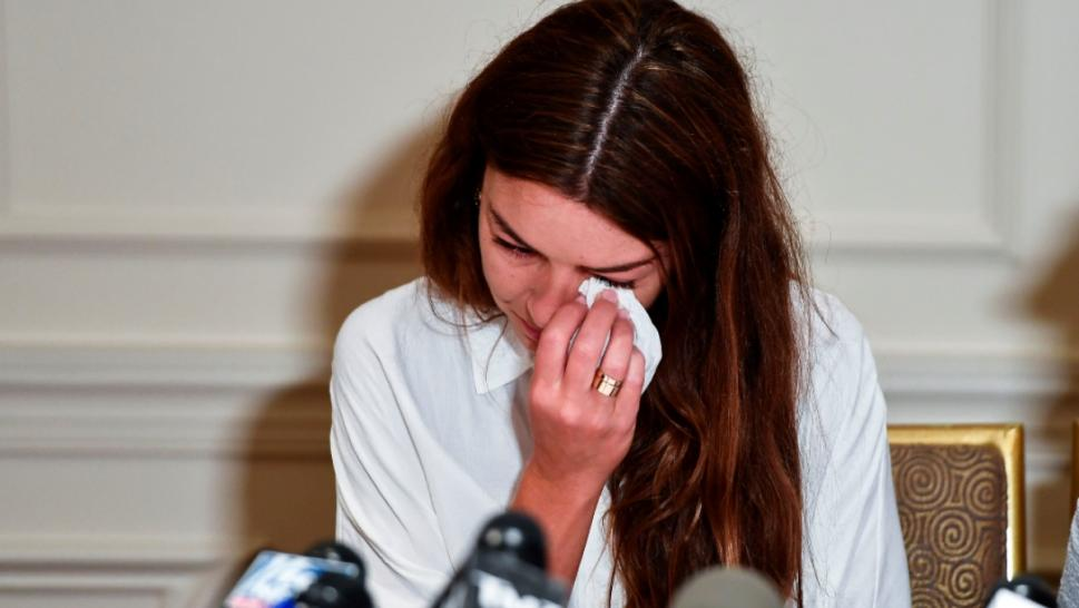 Miriam Haleyi crying at press conference