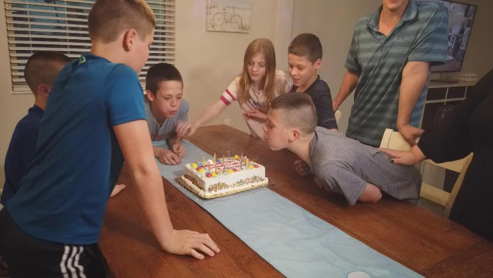 Inside Edition was there as the six preteens — Eli, Brady, Ryan, Jackson, Charlie and MacKenzie — crowded around the kitchen table to blow out the candles on their birthday cake.