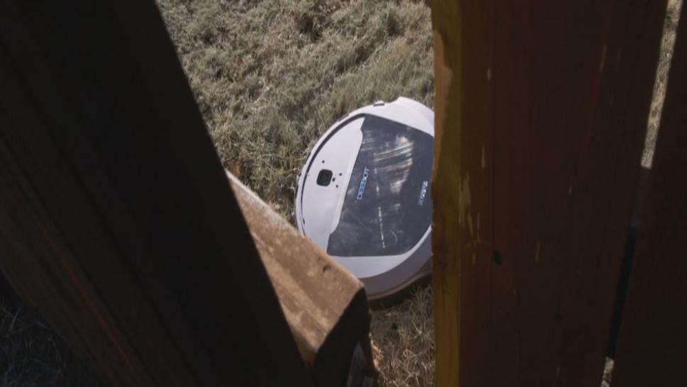 Roomba near fence