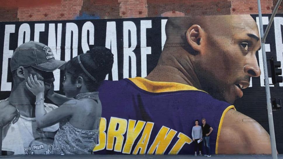 Father and daughter at a Kobe Bryant mural