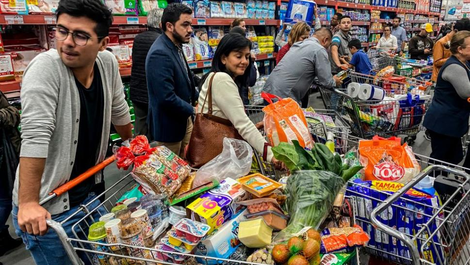Shoppers stock up on food as coronavirus crisis deepens.
