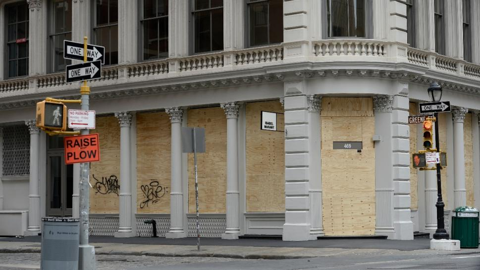 store front boarded up in NYC