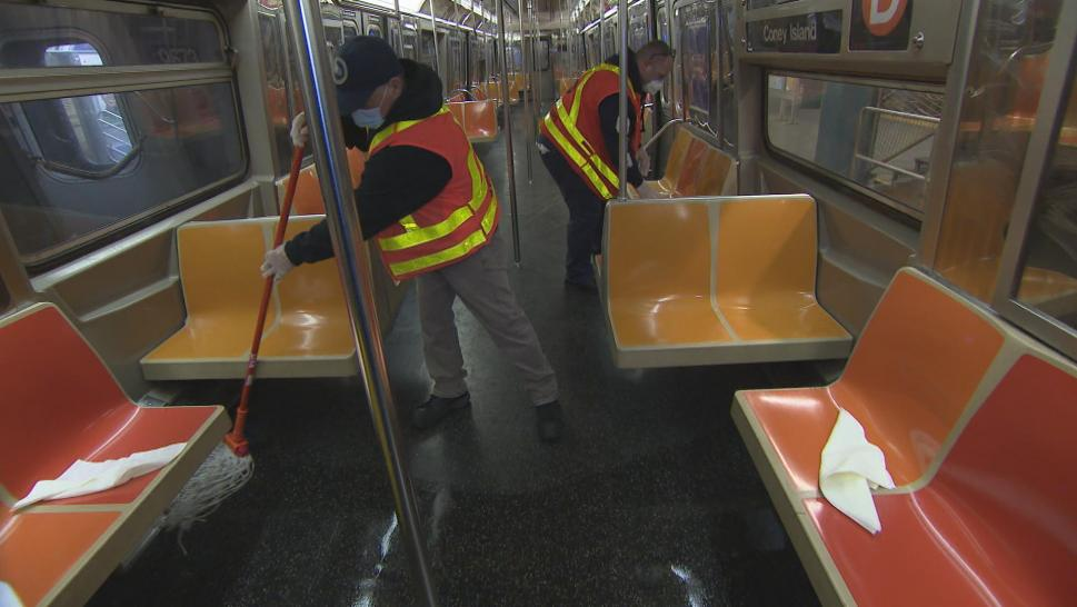 Workers cleaning the subway
